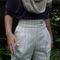 Laura_shorts_close_up_grid