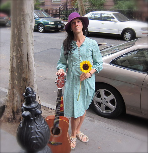 Cathy_with_flower_and_guitar_large