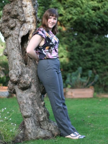 Grey_flannel_trousers_-_against_tree_large