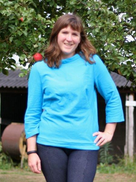 Turquoise_sweatshirt_-_hand_on_hip_smiling_large