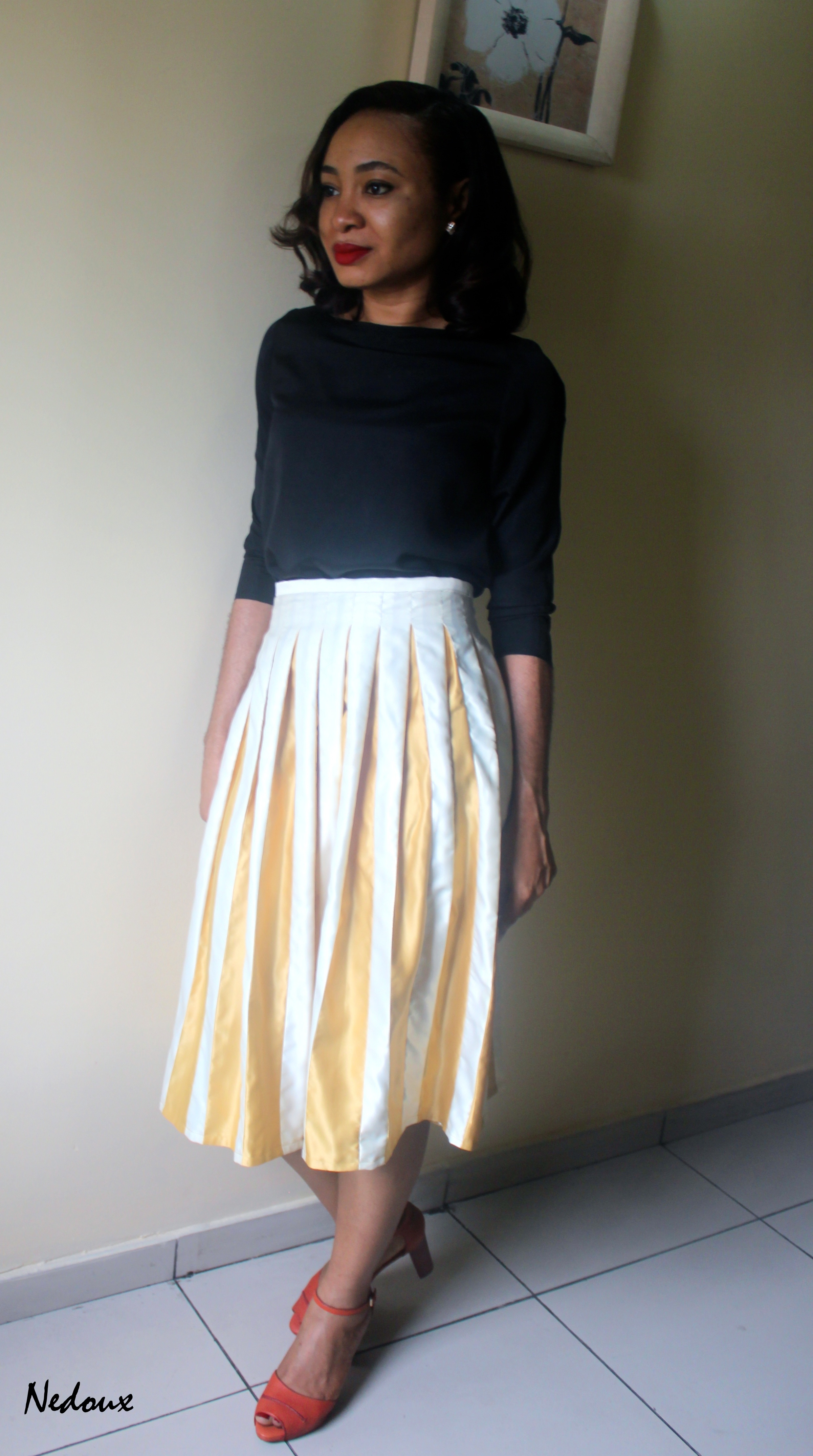 Inverted Pleats With A Separate Underlay Midi Skirt