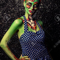 60568829-frightening-pin-up-zombie-girl-over-dark-background-body-painting-project-halloween-make-up-horror--stock-photo_listing